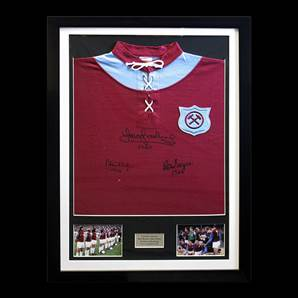 West Ham shirt of 1923, signed by Boyce, Taylor & Brooking, framed
